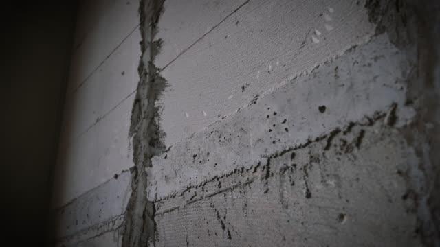 石膏セメント壁構造のテクスチャ - 起伏のある点の映像素材/bロール