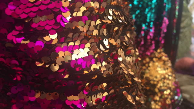 texture scales with bright sequins close-up - sequin stock videos & royalty-free footage