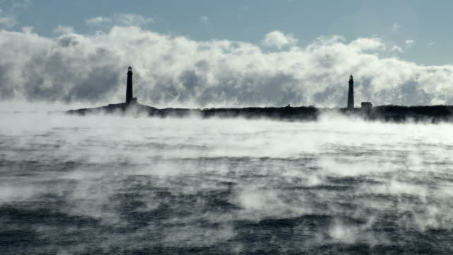 thacher island twin lights in arctic sea smoke - lighthouse stock videos & royalty-free footage
