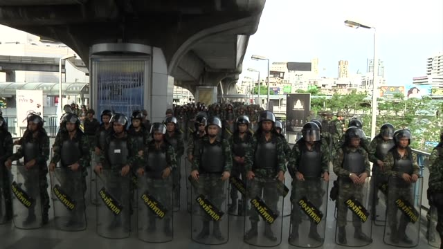 thai army stands in a show of force as more than 5000 soldiers were deployed to counter any anti-coup protests near the stadium bts in bangkok on... - coup d'état stock videos & royalty-free footage