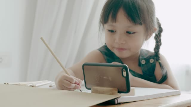 thai baby girl with her hobby - pencil drawing stock videos & royalty-free footage