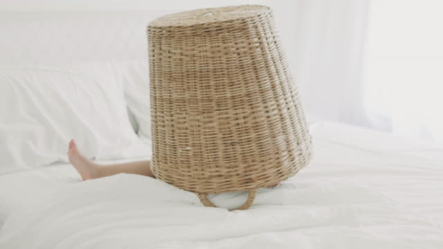 vídeos de stock e filmes b-roll de thai baby girl with peekaboo game by hiding in a basket on her white bedroom-modern lifestyles of thai family - esconder