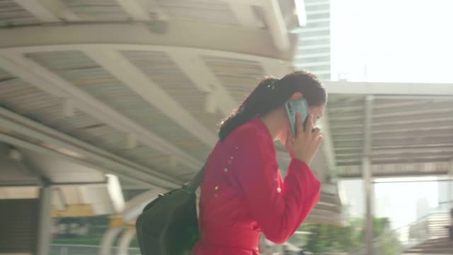 Thai beautiful business woman is using phone