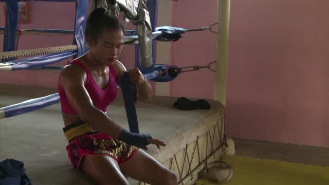 thai boxer nong rose is preparing for a foreign debut that will make her the first transgender fighter to enter the ring in france - building entrance stock videos & royalty-free footage