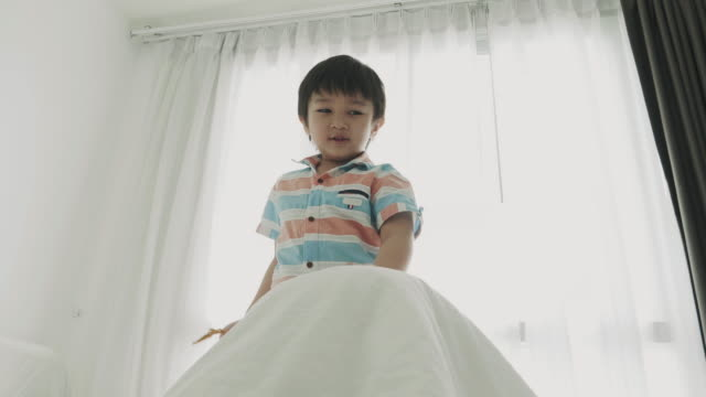 thai boy and sister playing hide and seek game - peekaboo game stock videos & royalty-free footage