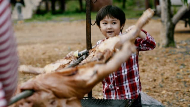 thai boy grill pig - roasted stock videos & royalty-free footage