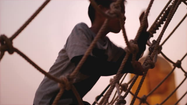 thai boy is climbing to the top of rope on the playground - rope stock videos & royalty-free footage