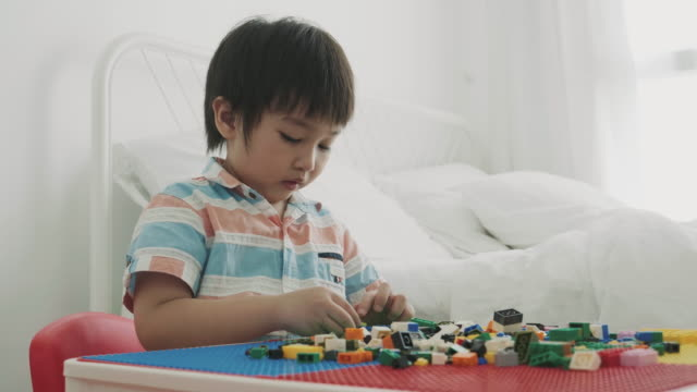 thai boy is playing toy block - baby boys stock videos and b-roll footage