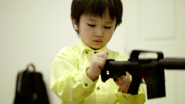 thai boy is playing toy gun at home - toy gun stock videos & royalty-free footage