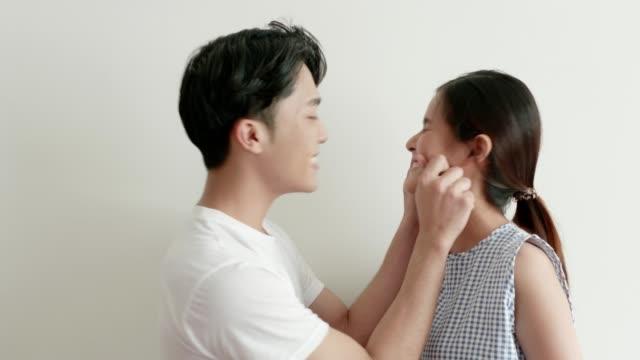 thai boyfriend pinching woman's face - stock video - pinching stock videos & royalty-free footage