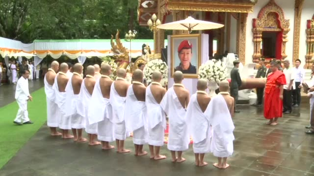 thai boys rescued from deep inside a flooded cave in a dramatic mission take part in a buddhist ordination ceremony in honour of a diver who died... - ceremony stock videos and b-roll footage