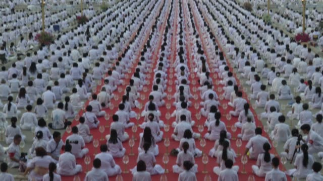 thai buddhists and devotees take part in a candle lighting ceremony at wat phra dhammakaya in bangkok thailand during the buddhist holiday of makha... - cult stock videos & royalty-free footage