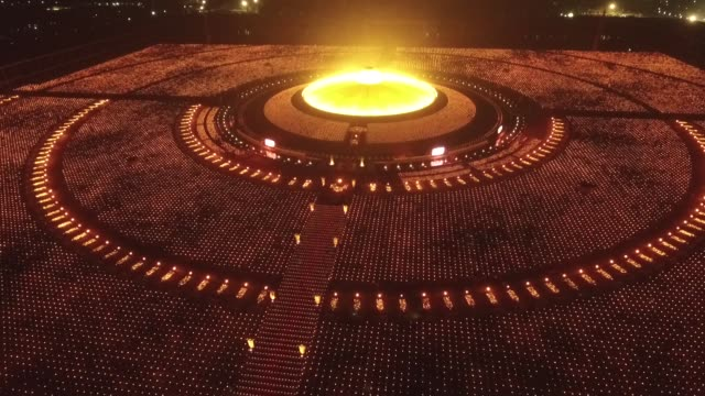 thai buddhists and devotees take part in a candle lighting ceremony at wat phra dhammakaya in bangkok thailand during the buddhist holiday of makha... - candlelight stock videos and b-roll footage