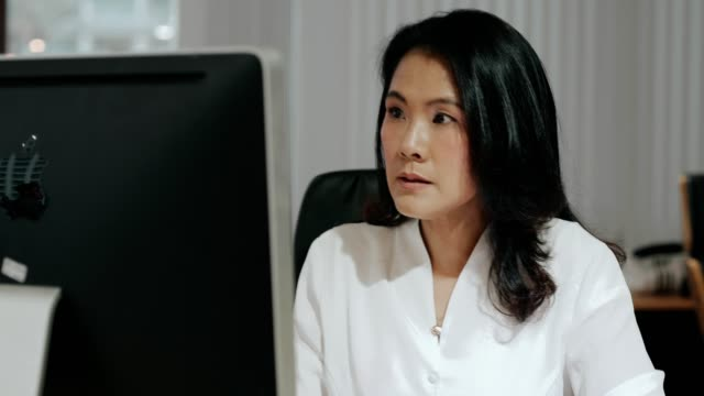 Thai businesswoman manager checking and reading email, shock that forget the business meeting for today, checking calendar