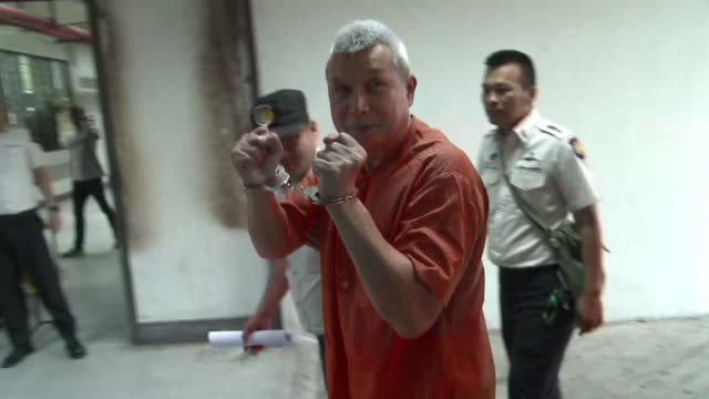 a thai court acquitted a folk singer turned activist of his third royal defamation charge a rare ruling under a draconian law that is used to shield... - acquittal stock videos and b-roll footage