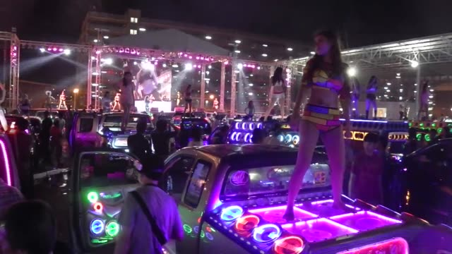Thai Coyote Dancer Dance on trucks in a parking lot at the Impact Arena during the Bangkok International Motor Show in Bangkok Thailand