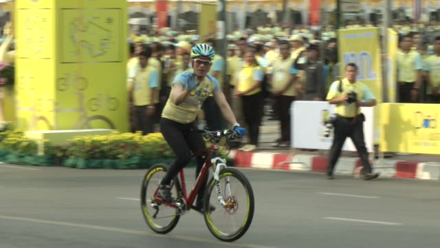 Thai Crown Prince Maha Vajiralongkorn rides at the start of the in the 'Bike for Dad' event in Bangkok / He led thousands of cyclists on a 29km...