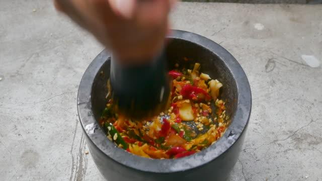thai cruise,chili garlic pound mixed by mortar and pestles homemade paste spicy herb ingredient of Thai food,thai cruise