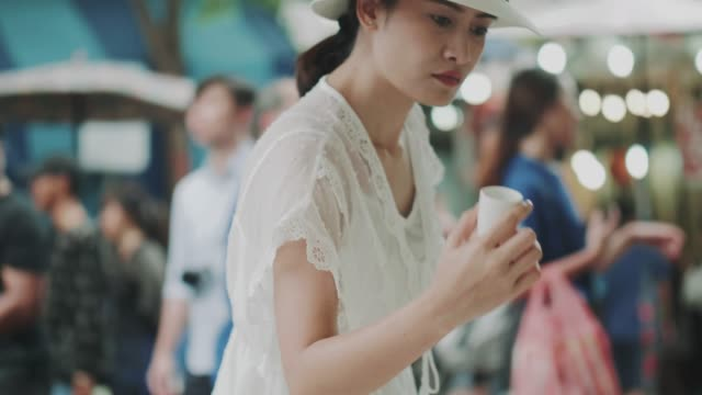 thai customer women is choosing coffee cup at the market on weekend - mug stock videos & royalty-free footage