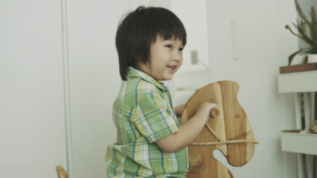 Thai Cute Baby Boy Is Playing Horse Bench At The Bedroomf Stock Footage Video Getty Images