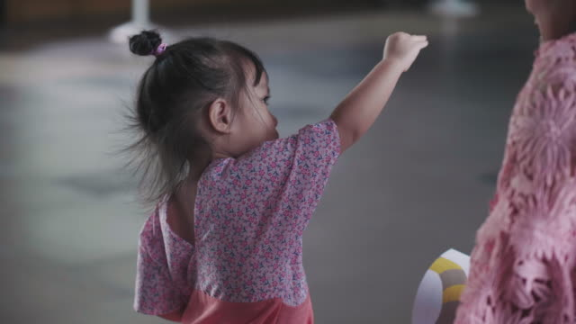 thai cute baby girl is acting imagination of bird while mother is teaching - copying stock videos & royalty-free footage