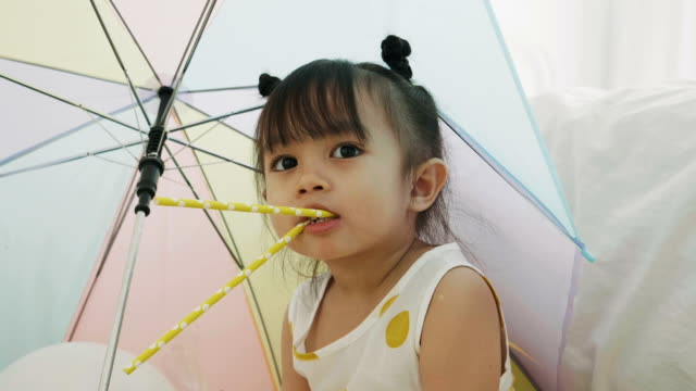 thai cute baby girl is biting straw - straw stock videos & royalty-free footage