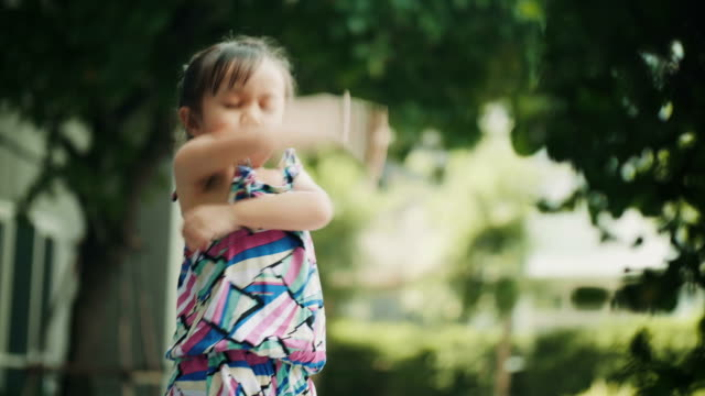 vídeos de stock e filmes b-roll de thai cute baby girl is cross one's arm with sulking and touchy at the garden - povo tailandês