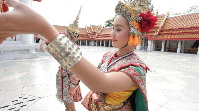 Thai dancers perform in a temple courtyard in Bangkok.