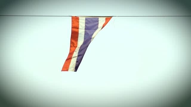 Thai flag over blue sky