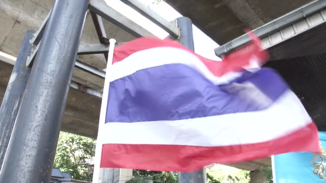 a thai flag waves near the police investigation where a bomb thrown in a canal inlet near the saphan thaksin bts and river they prepare to drain the... - inlet stock videos & royalty-free footage