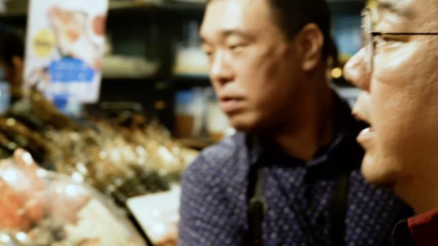 thai food at night street market - thai food stock videos and b-roll footage