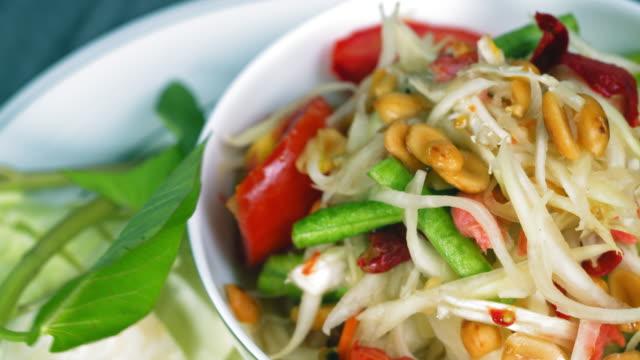 thai food: papaya salad - thai food stock videos & royalty-free footage