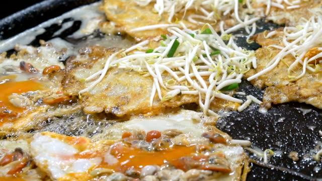 thai fried mussels pancake (hoi tod). - june stock videos & royalty-free footage
