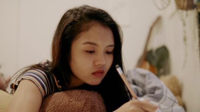 thai girl is sketching ideas-stock video - animator stock videos & royalty-free footage