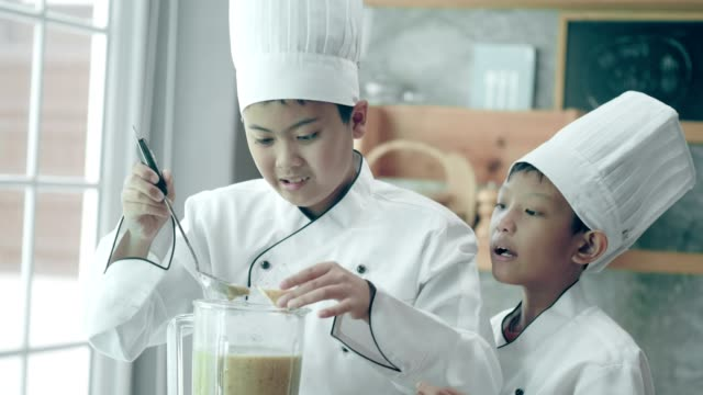 thai junior school chef doing juice and tasting the new menu at school cooking class - east asian ethnicity stock videos & royalty-free footage