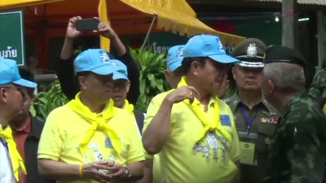 thai junta leader and prime minister prayut chan-o-cha visits the cave in northern thailand where 12 children and their football coach have been... - prime minister video stock e b–roll