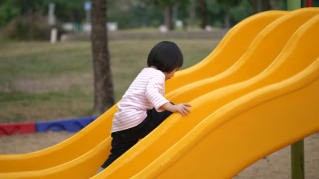 Thai little girl is playing at the playground -video stock