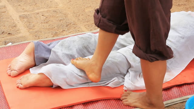 Thai Local Massage by using foot