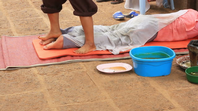 thai local massage by using foot - massager stock videos and b-roll footage