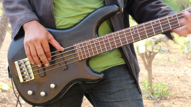 thai male hands playing bass guitar. - bass guitar stock videos & royalty-free footage