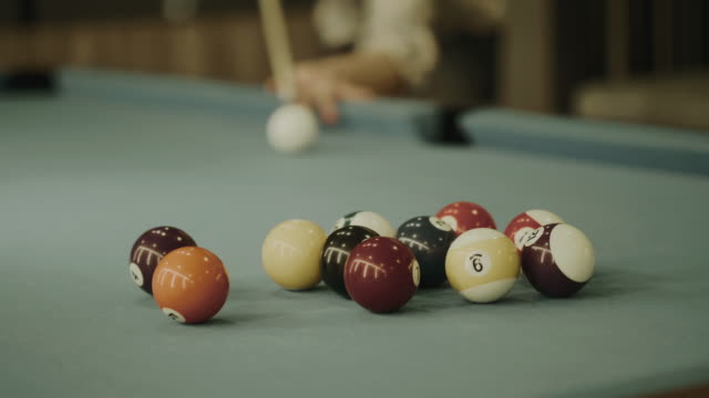 thai man is playing  billiard balls snooker - stock video - pool table stock videos & royalty-free footage