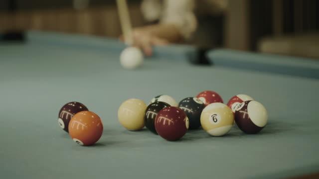 Thai man is playing  billiard balls snooker - Stock video