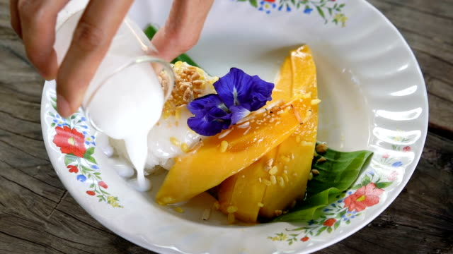 slo mo thai mango sticky rice (khao niaow ma muang). - sticky stock videos and b-roll footage