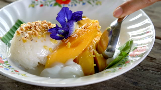 thai mango sticky rice (khao niaow ma muang). - stick plant part stock videos & royalty-free footage