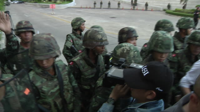 thai military secure take control of the army club grounds after a military coup where prime minister yingluck shinawatra was detained along with... - coup d'état stock videos & royalty-free footage