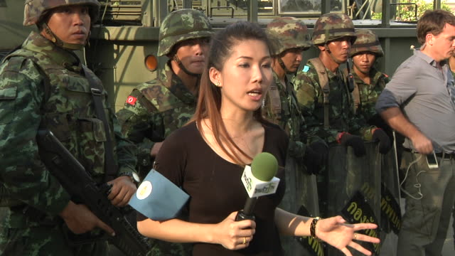 Thai Military secure take control of the Army Club grounds after a military coup where Prime Minister Yingluck Shinawatra was detained along with...