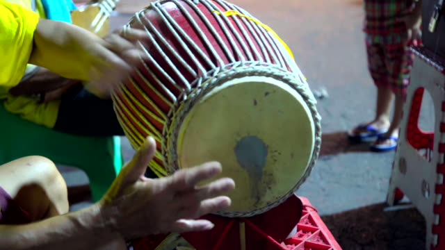 Thai Musician Play Thai Traditional Ancient Drum Instrument.