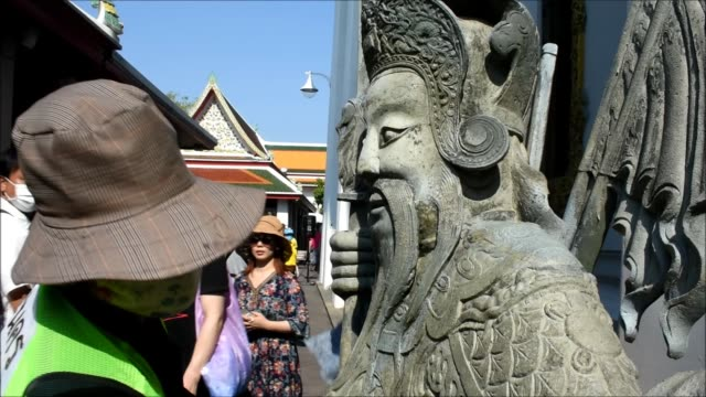 thai official cleans on ancient statue as a precaution against the coronavirus covid-19 outbreak at wat pho in bangkok on march 13, 2020. - bangkok stock videos & royalty-free footage