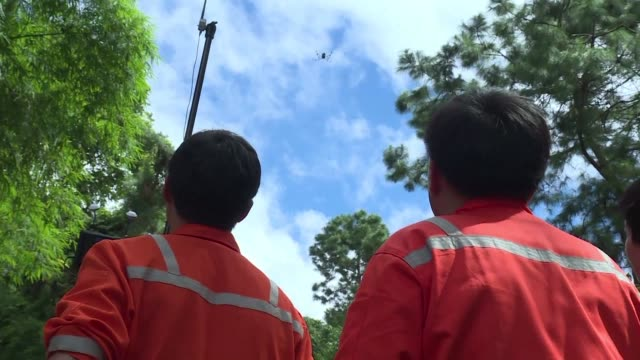 thai oil company workers test a thermal imaging drone in the mountain of khun nam nang non forest park in chiang rai province to help find 12 young... - rescue stock videos and b-roll footage