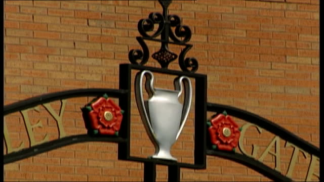 Sports Minister concern ITN Liverpool Anfield Liverpool FC crest on wall of ground TILT GV Stadium